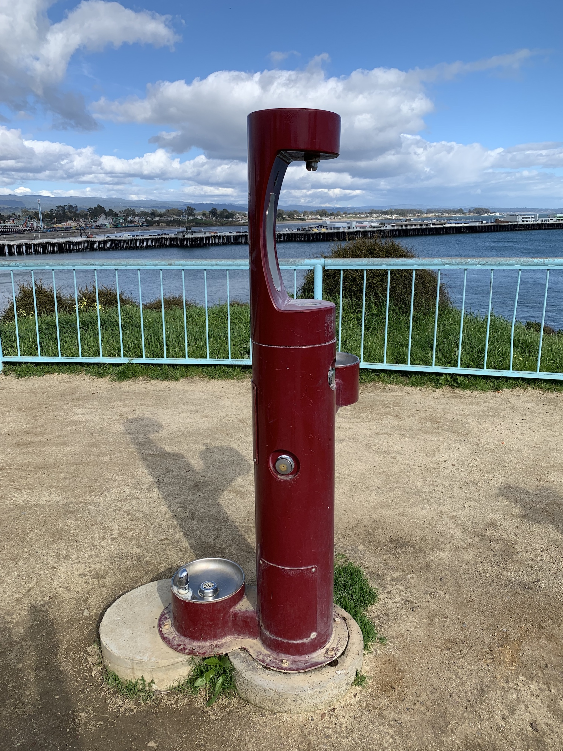 water fountain with bottle filling station on cliffs overlooking ocean