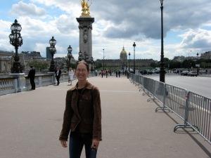 Mary on a bridge in Paris